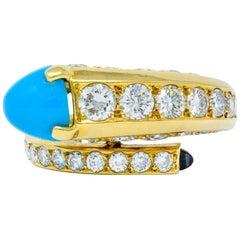 1970s Cartier Paris Diamond Turquoise 18 Karat Gold Bypass Ring, circa 1970s