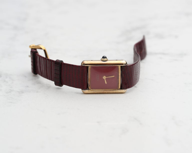 1970s Cartier Tank Vermeil Wristwatch with Maroon Dial It comes on a custom alligator maroon strap and has the original Cartier clasp.