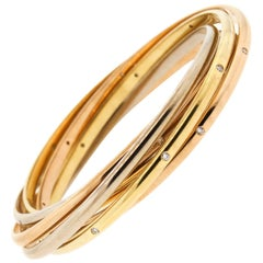 1970s Cartier Tri-Color 18 Karat Gold Diamond Rolling Ring Bangle