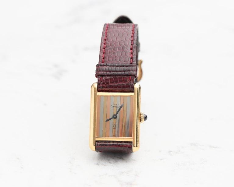 Cartier Vermeil Tank with Tricolored Gold Dial 1970s   Features: Wind up movement Sapphire Crown  Original Cartier Clasp  Burgundy Crocodile Cartier Strap
