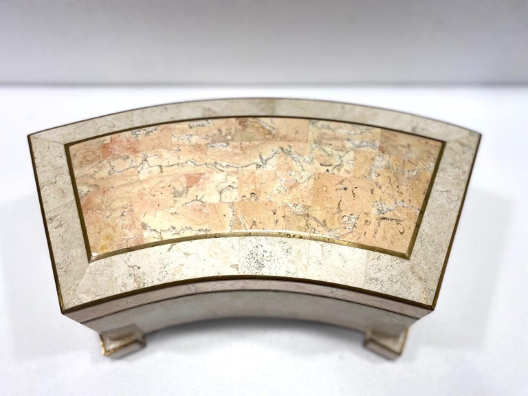 Mid-Century Modern large tessellated marble and stone jewelry box. The footed box features a plinth architectural curved frame with brass metal inlays and trim accent along all edges. Removable lid opens to a luxe felt interior in chocolate brown.