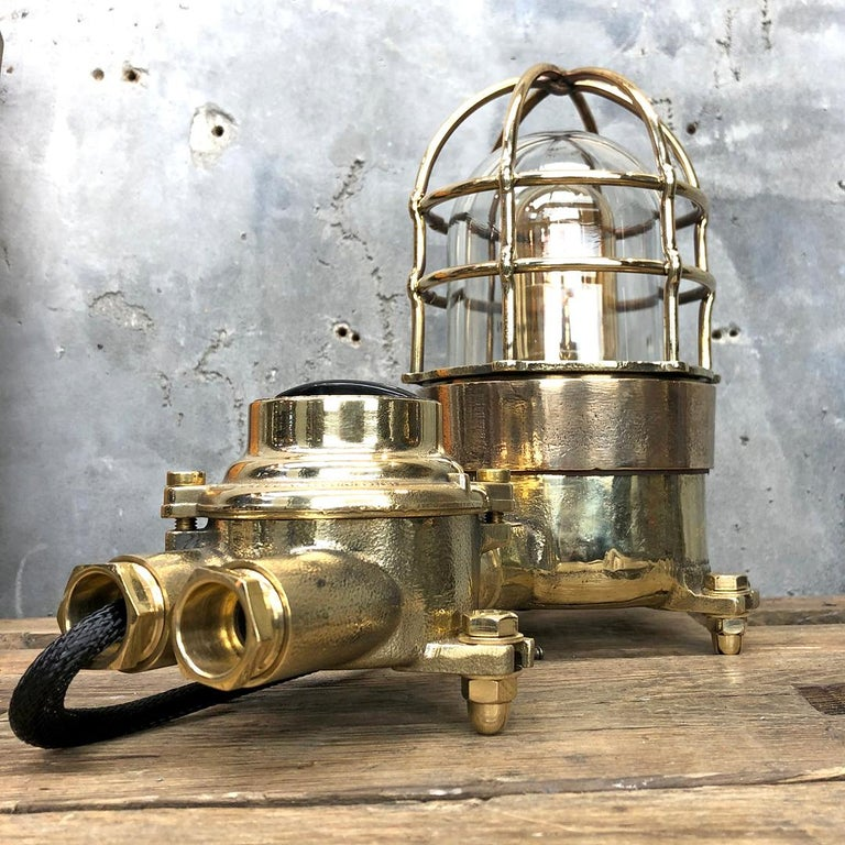 A vintage Industrial cast bronze and brass explosion proof table lamp with an isolator switch manufactured circa 1975 by Wiska and Centurion who are manufacturers of Ex. (explosion proof) rated fixtures. The lamp comes fitted with a cast brass Wiska