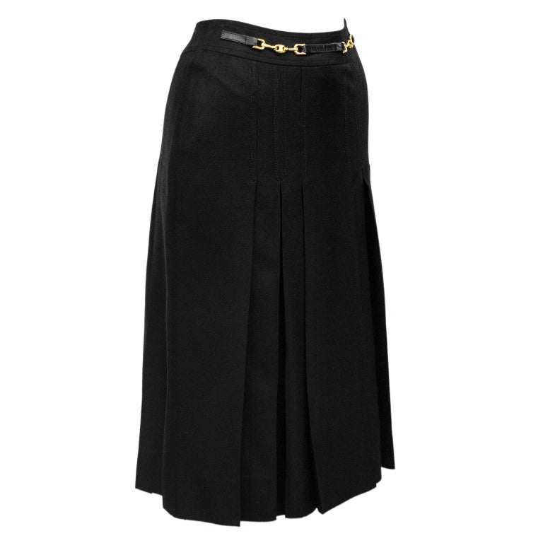 1970's classic Celine black viscose and silk skirt with half black leather and gold belt at waistband. Inverted stitched pleats on the front and back. Overall A line shape. In excellent condition, side zipper with hook and eye. Fits like a US size