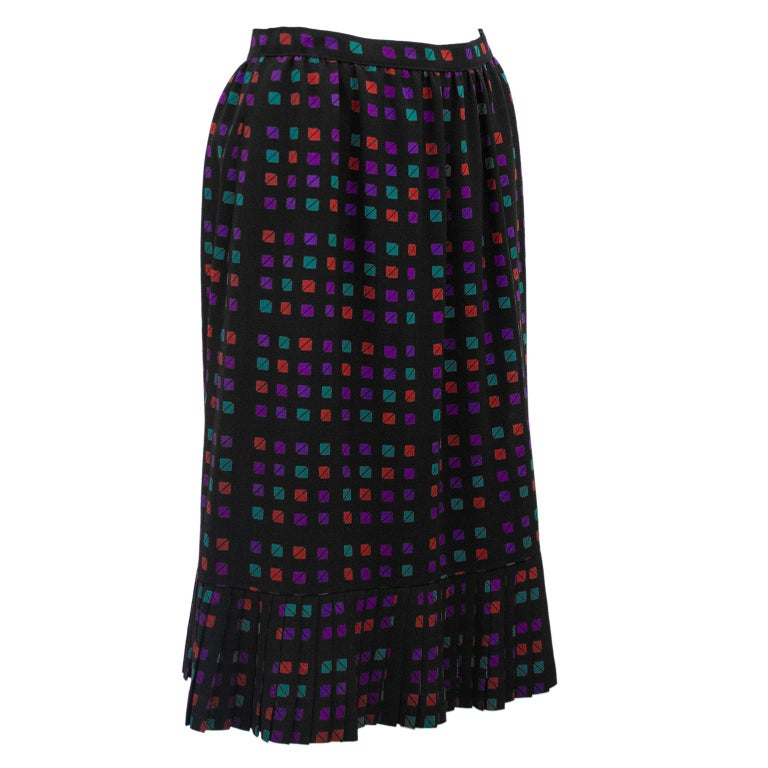 Fun & flirty 1970s Celine skirt. Black with turquoise, purple and red allover triangle/square geometric pattern. High waisted with slight aline shape and pleated hem. Excellent vintage condition. Fits like a US size 2