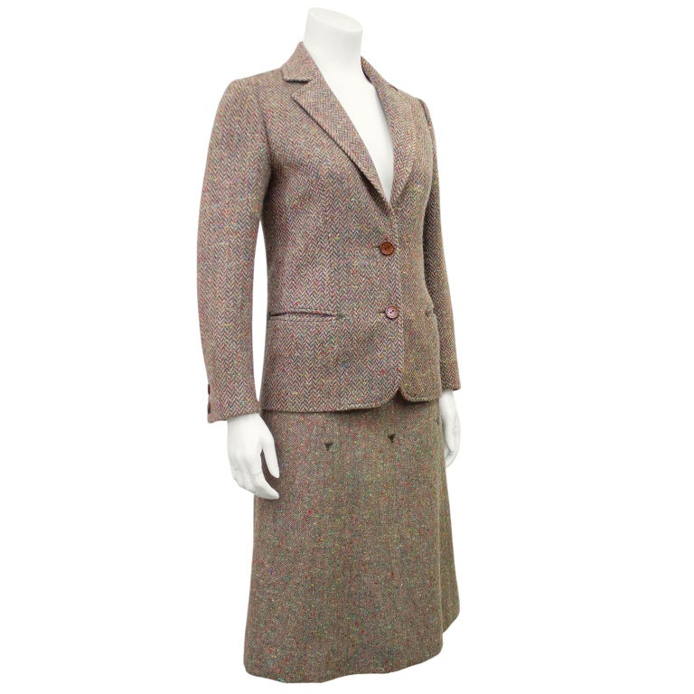 1970s Celine brown and multi colour herringbone wool skirt suit. Classic herringbone wool blazer with notched collar, horizontal slit pockets and branded brown buttons. Skirt is matching wool in Donegal pattern high waisted and A-line. Brown leather