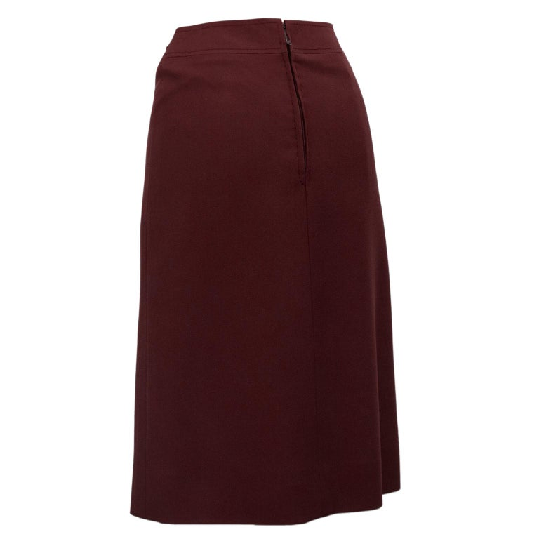 1970's classic Celine maroon wool gabardine wrap style skirt with pleating. Faux gold tone and leather maroon buckle at left hip. Overall A line shape. In excellent condition, side zipper with hook and eye. Fits like a US size 2. Made in France.