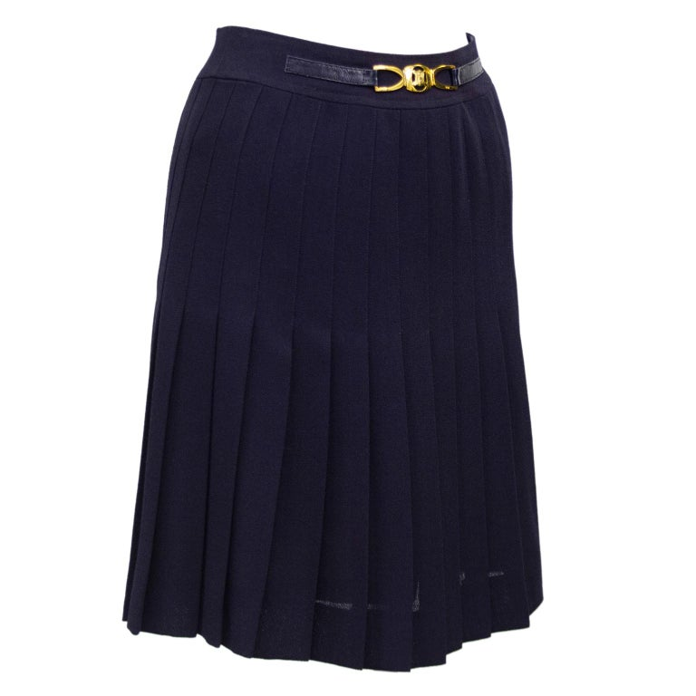 1970's classic Celine navy blue polyester and wool blend pleated skirt with half navy leather and gold belt at waistband. Overall A line shape. In excellent condition, back zipper with hook and eye. Fits like a US size 2. Made in France. Iconic