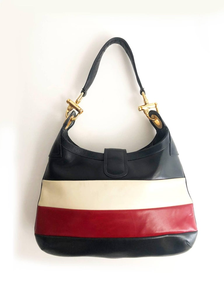 Rare Celine Paris tote bag in thick leather, navy blue, red and white stripe , gold tone metal ware, interior in navy blue leather, inside zipped pocket, Made in Italy    Condition: 1970s, excellent vintage, slight sign of wear consistent with age