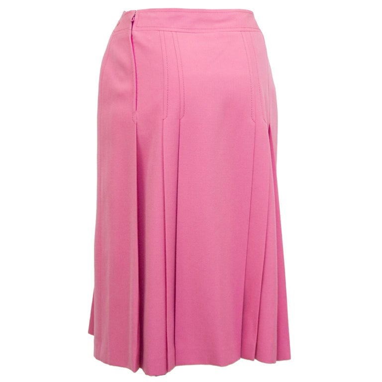 1970's Celine pink wool skirt with leather and chain details at waistband. Inverted box pleats on the front and back. Overall A line shape. In excellent condition, side zipper with hook and eye. Marked FR 40. Matches our Celine Pink Wool Cable Knit