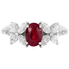 1970s Center Ruby and Flower Pear Shape Diamonds Ring