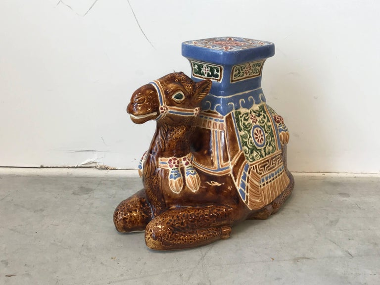 Offered is a fabulous, 1970s glazed-ceramic camel sculpture garden stool. The piece is in exquisite condition -- no chips, cracks, or discoloration. Perfect indoors or outdoors!