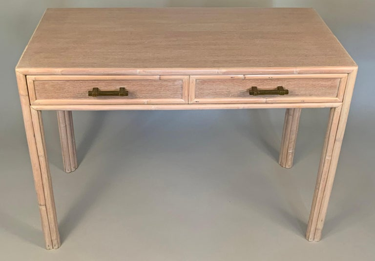 A beautiful 1970s writing desk by McGuire, with a very nice Cerused oak finish and rattan trim, with patinated brass drawer hardware. Wonderful details and scale.