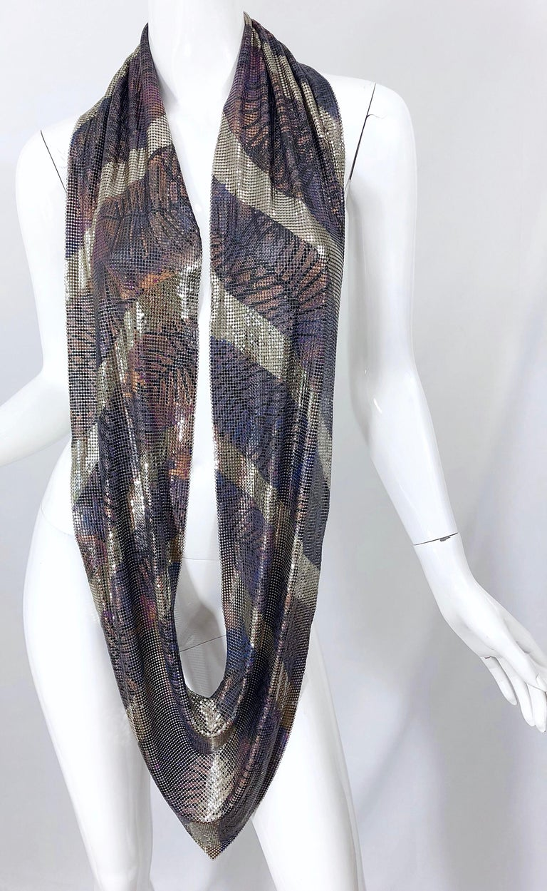 Amazing 1970s chainmail Paco Rabanne style metal scarf or sexy halter top! Features handpainted metal in purple, pink and silver. Leaf like symbols throughout. The perfect statement piece for any outfit! In great condition, and very well made. Will