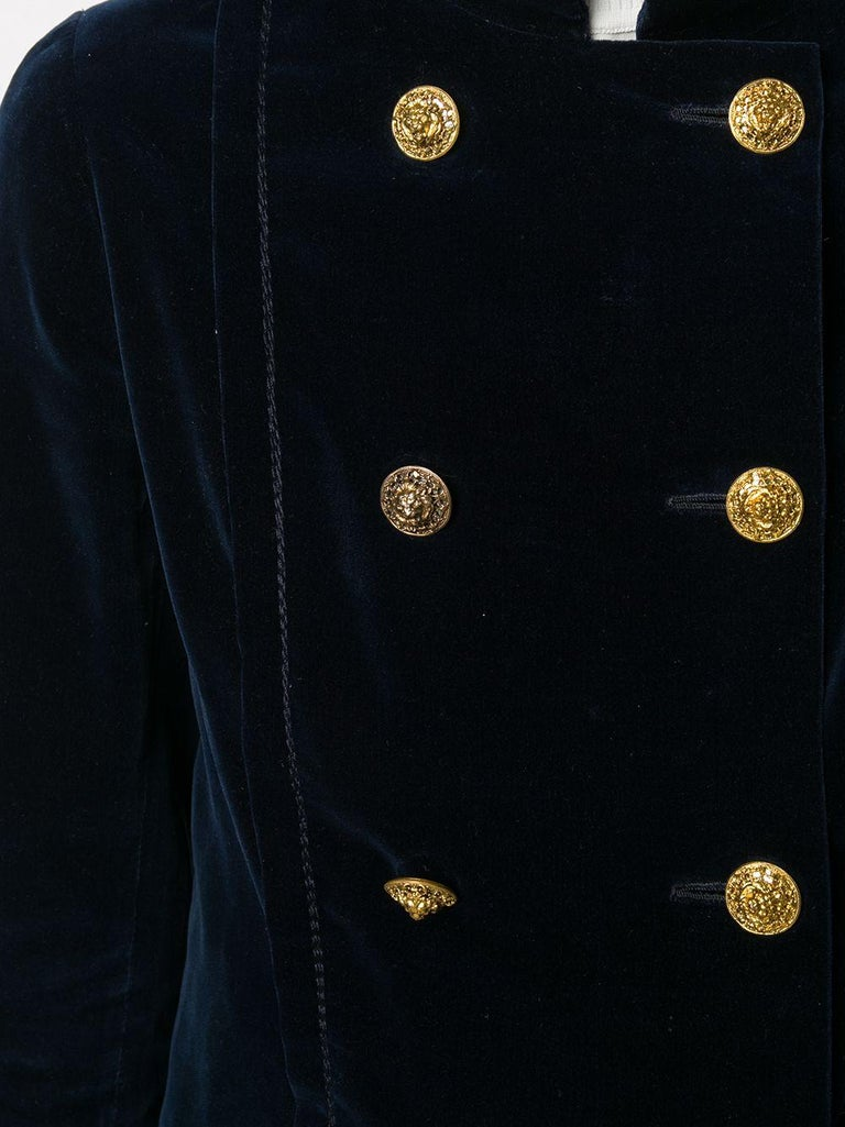 Chanel Haute Couture navy velvet jacket featuring a mandarin collar, double-breasted button fastening, front pockets, logo gold tone lions buttons, long sleeves, a silk lining, numbered 43833. Circa 1970s. Composition: 100%cotton  In good vintage