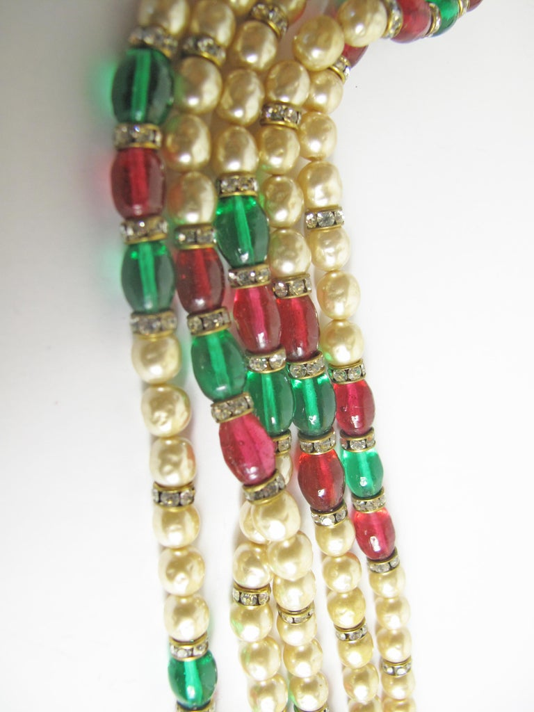 "1970s Gold-tone Chanel multi-strand necklace featuring crystal accents, gripoix, faux pearls and hook closure. Chain Length 36"" . Condition: Very good, light scratches and tarnish at metal."