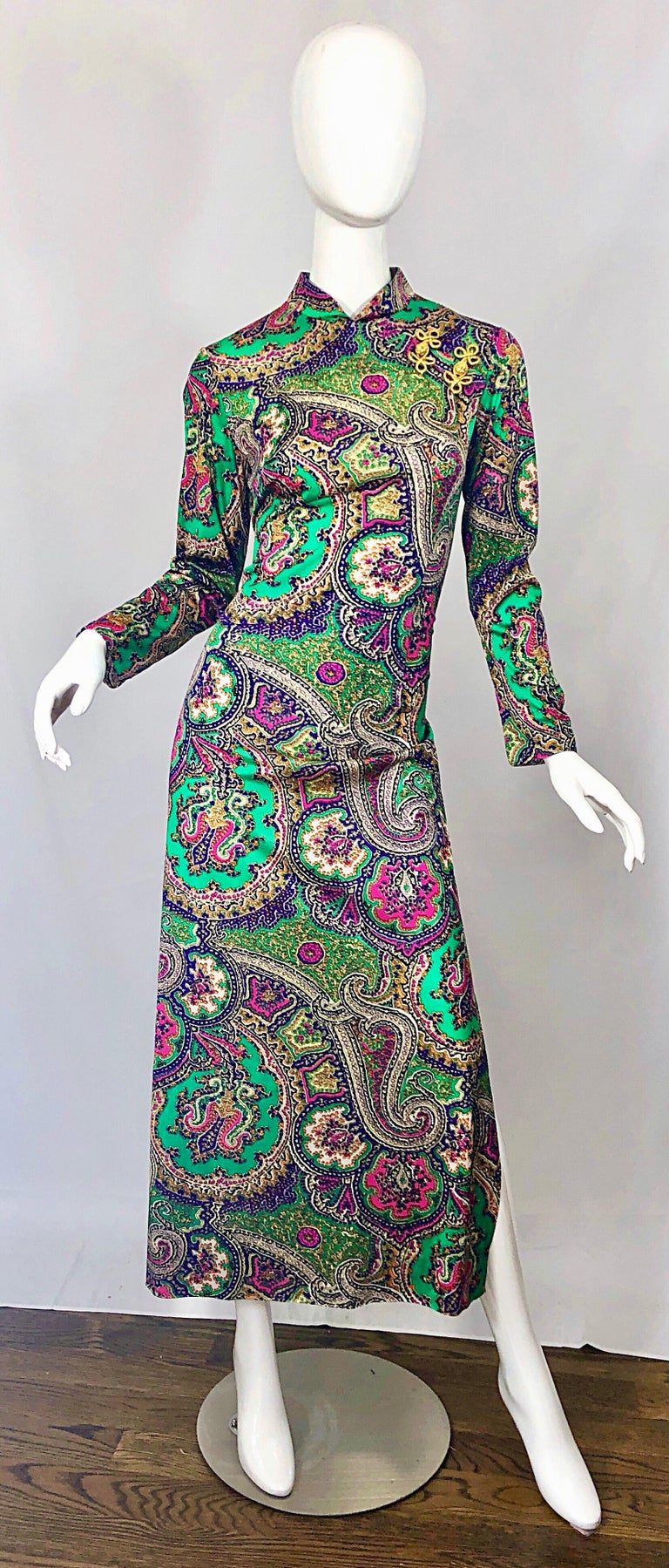Incredible vintage 70s cheongsam Asian inspired colorful paisley print jersey maxi dress! Features metallic gold embroidery at top left shoulder. Vibrant colors of kelly green, purple, pink, fuchsia and white throughout. Full metal zipper up the