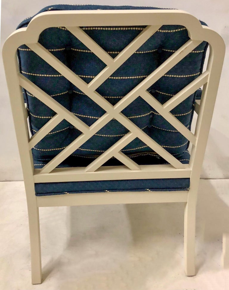 These Erwin Lambeth chairs date to the 1970s. They have Chinese chippendale styling and have been given a fresh update with a satin linen white paint and textured linen upholstery. They are marked and in very good condition. See the available