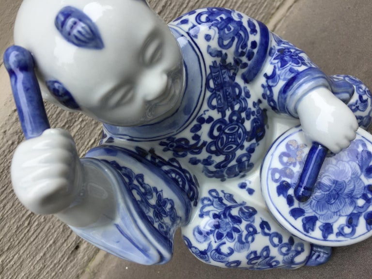 1970s, chinoiserie blue and white porcelain sculpture baby Buddha with drum 1970s, Asian baby Buddha with drum figurine. Perfect to add to your collection. An adorable one of a kind piece.
