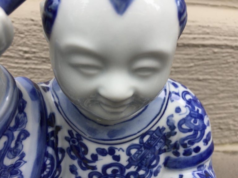 1970s, Chinoiserie Blue and White Porcelain Sculpture Baby Buddha with Drum In Good Condition For Sale In Chicago, IL