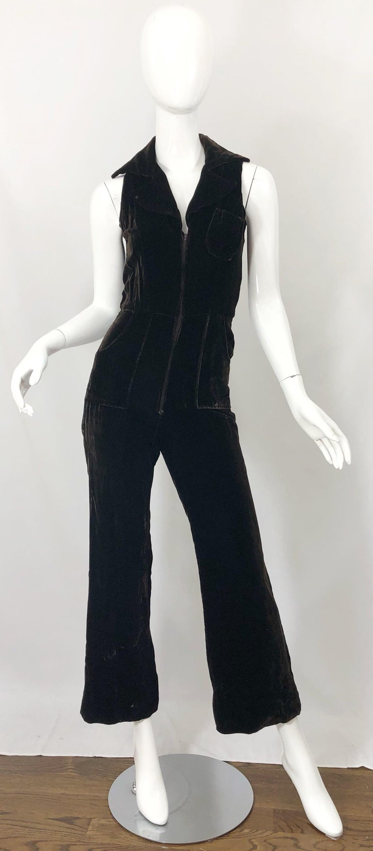 Awesome vintage 70s chocolate brown velvet bell bottom one piece jumpsuit! Features a fitted tailored collared bodice and trousers that leads to wide flared legs. Pocket at left breast and at the side of each hip. Hidden zipper up the front. Super
