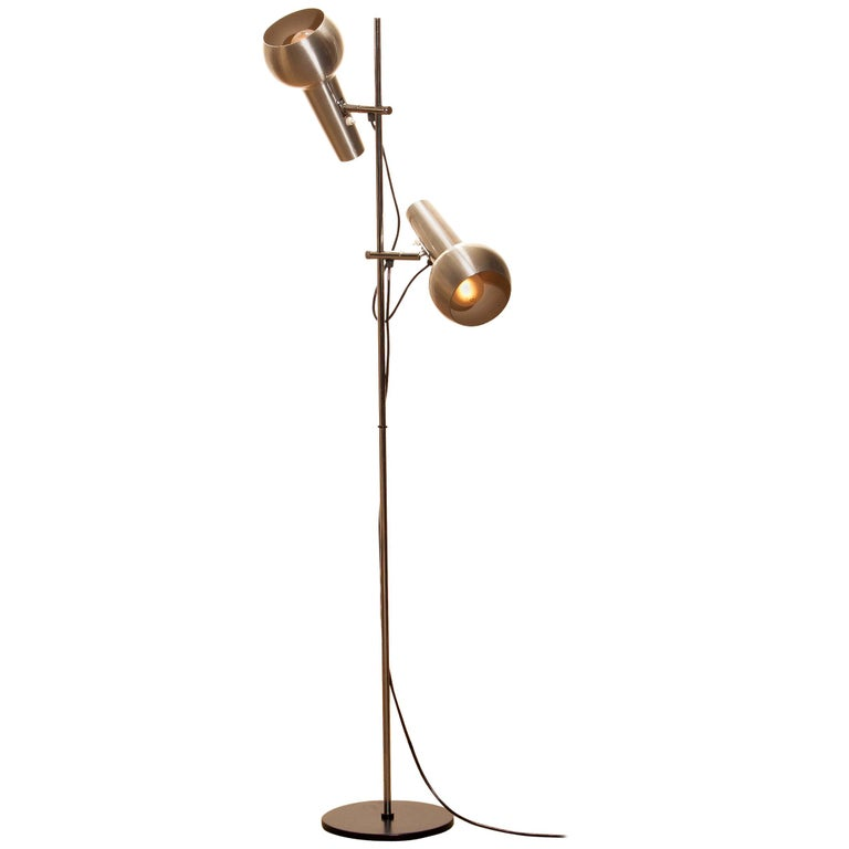 Typical 1970s floor lamp with two big adjustable heads in chrome and aluminium combination and made by Koch & Lowy, 1970s. In good condition and technical 100%. Both lamps or shades are with a switch provided. Period: 1970s. The dimensions are