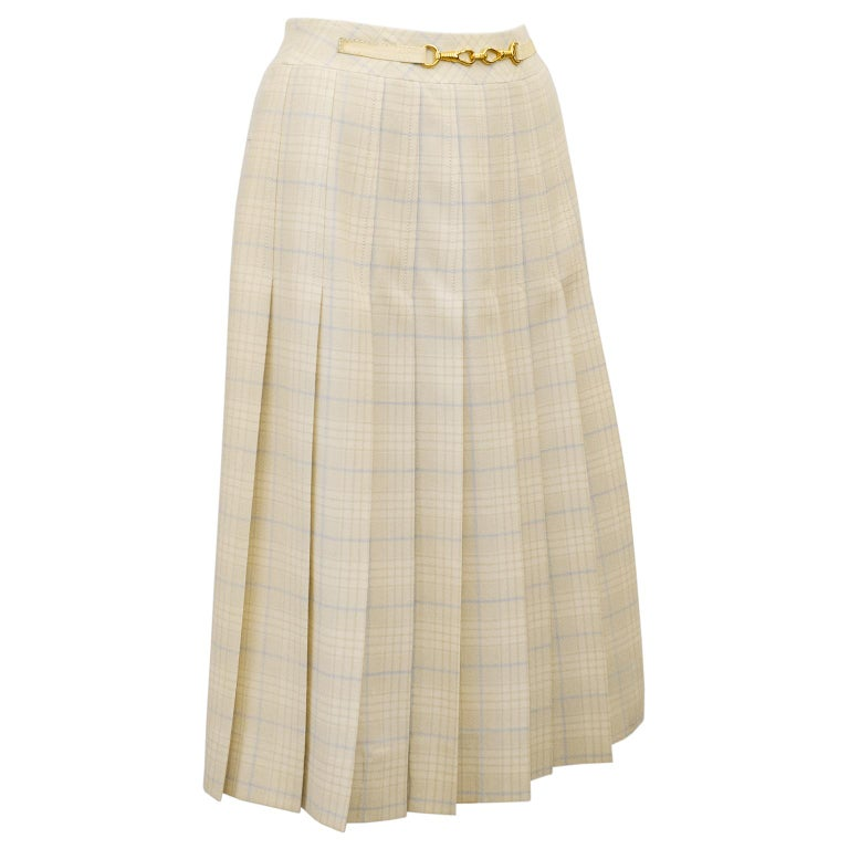 1970's classic Celine cream and pale blue wool tartan pleated skirt with half cream leather and gold belt at waistband. Inverted stitched pleats on the front and back. Overall A line shape. In excellent condition, side zipper with hook and eye. Fits