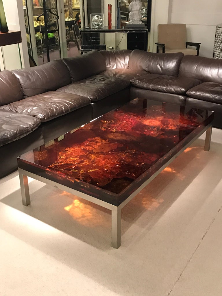 1970s resin fractal coffee table by Marie-Claude de Fouquieres. Table feet is in stainless steel Resin looks like amber. Good vintage condition  Fouquieres Marie-Claude A wife of a major plastic manufacturer, Marie-Claude de Fouquieres made