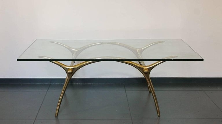 1970s coffee table in glass an polished brass by Belgian designer Kouloufi.