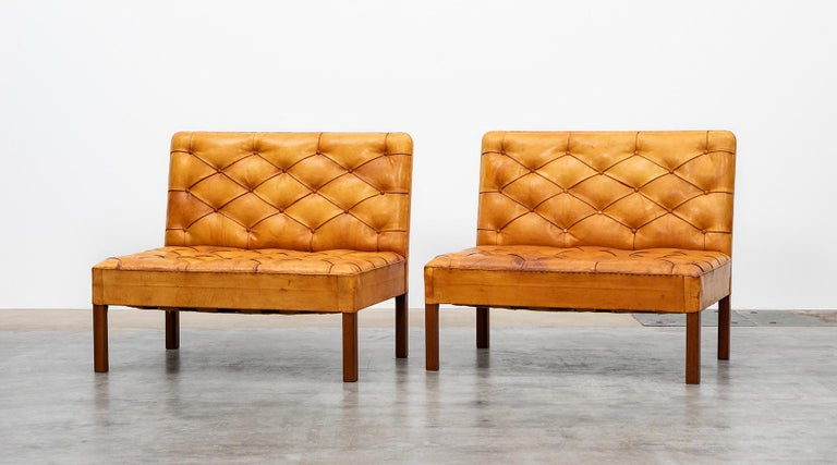 Sofa units by Kaare Klint for Rud Rassmussen, niger leather, mahogany, Denmark, 1933.  Two exceptional pieces that stand for midcentury design in its highest quality class. Excellent pair of freestanding mahogany sofas. All sides, seat and back