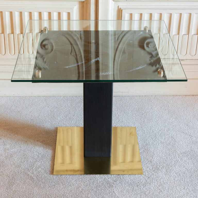 Square side table realized with a figurative black terracotta low relief signed