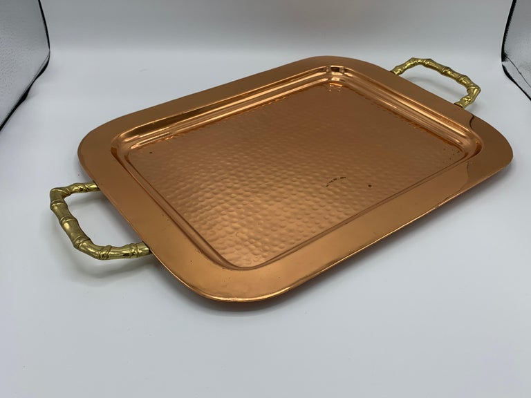 Offered is a stunning, 1970s hammered-copper tray with thick brass faux-bamboo handles. Heavy, 3.5lbs.