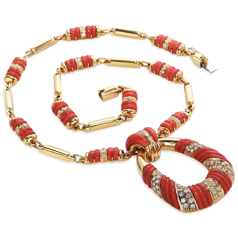 Vintage Retro 1950s Italian Made, with Diamonds & Carved Coral Bar link design chain with pendant,  Crafted in solid 18K yellow gold, composed by  110 round-cut, pave-set,  Diamonds weighing approximately 2.70carats  G-Hcolor and VSclarity  With