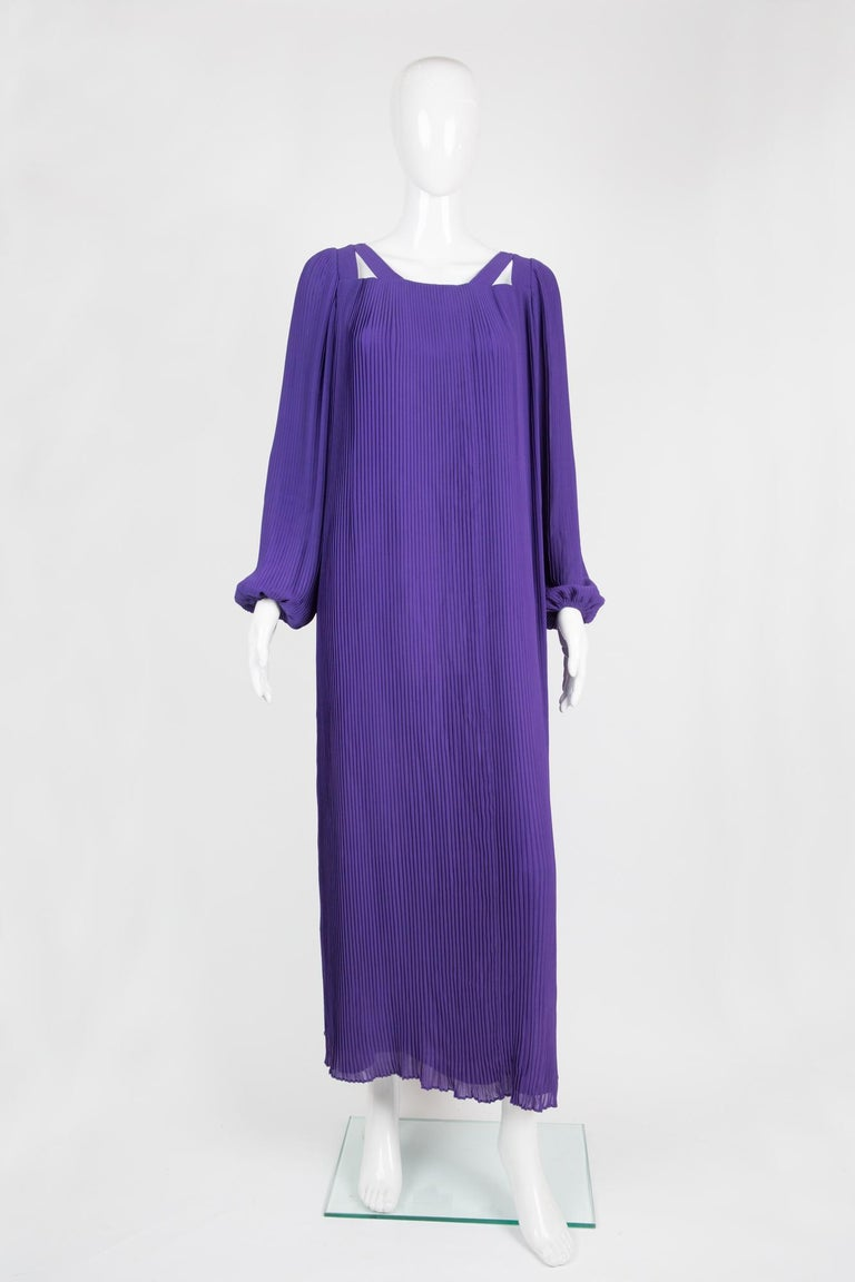 1970s Haute Couture Philippe Venet purple pleated dress featuring a decorative open neck line, all over pleated fabric, long sleeves with elasticated cuffs, a center back zip opening with little snaps, all hand made. See attached image Officiel