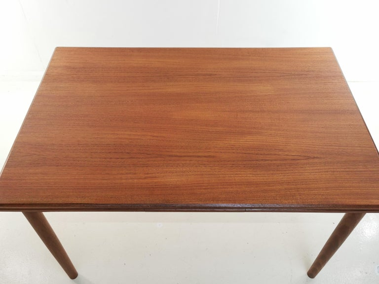 Danish teak extending dining table  Midcentury teak Danish extending dining table by Clausen and Son.   An excellent example, in superb condition. All parts are running smooth.   Simple, with clean lines and a practical quality made dining