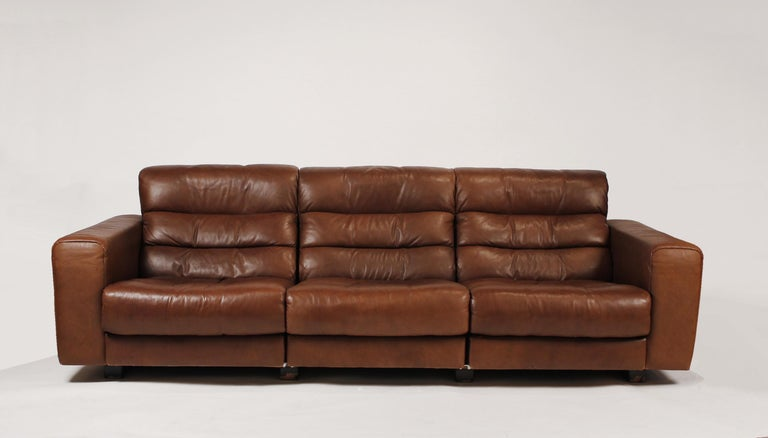 Rare, early 1970s 'De Sede of Switzerland' reclining sofa upholstered in the original chocolate buffalo hide leather. This sofa is in exceptional condition and was very seldomly used by the original owners. It is very comfortable and is suitable for
