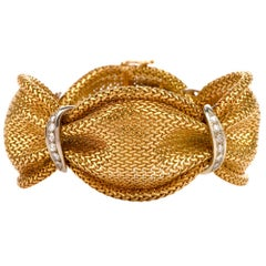 1970s Diamond 18 Karat Braided Yellow Gold Flexible Wide Bracelet