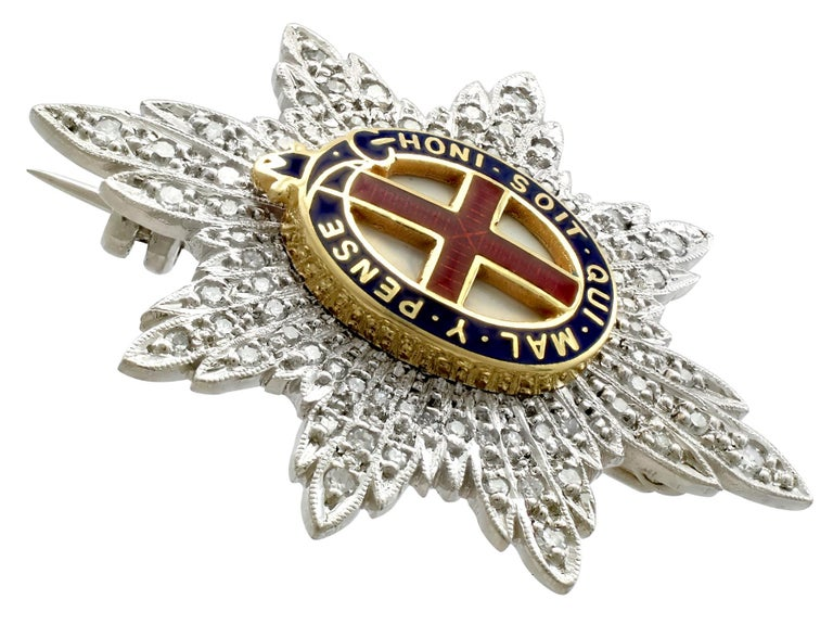This fine and impressive diamond brooch has been crafted in 18ct white gold.  The regimental sweetheart brooch has been modelled in the form of the cap badge of The Coldstream Guards, comprising a millegrain decorated garter star mounted with