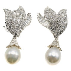 1970s Diamond Dangling Pearl Night and Day Platinum Earrings