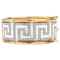 1970s Diamond White Enamel Greek Key 18 Karat Bangle Bracelet