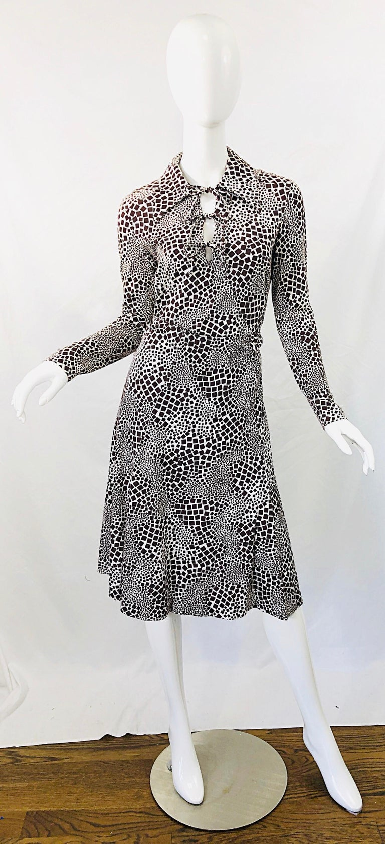 Chic 1970s DIANE VON FURSTENBERG chocolate brown and white abstract print cut-out shirt and skirt. Soft rayon and cotton blend fabric. Cut-out at center neck with three ties. Skirt features hidden metal zipper up the back with hook-and-eye closure.