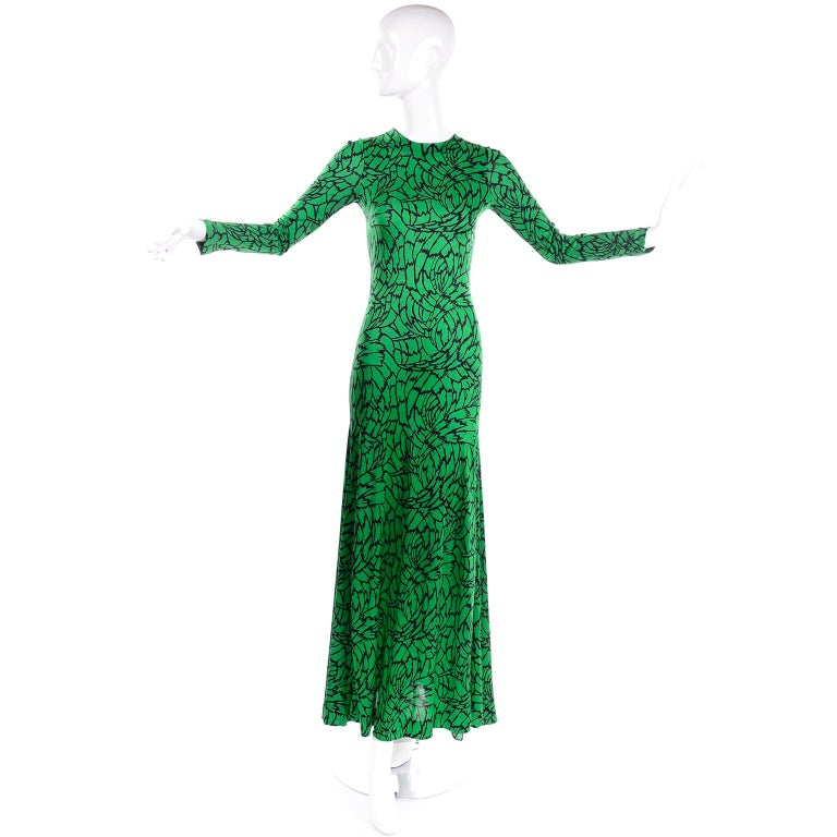 This is a lovely vintage DVF dress from the 1970's in a rich grass green and black abstract botanical print.  The dress was designed by Diane Von Furstenberg during the period that made her famous for her jersey dresses.  This one has an incredible