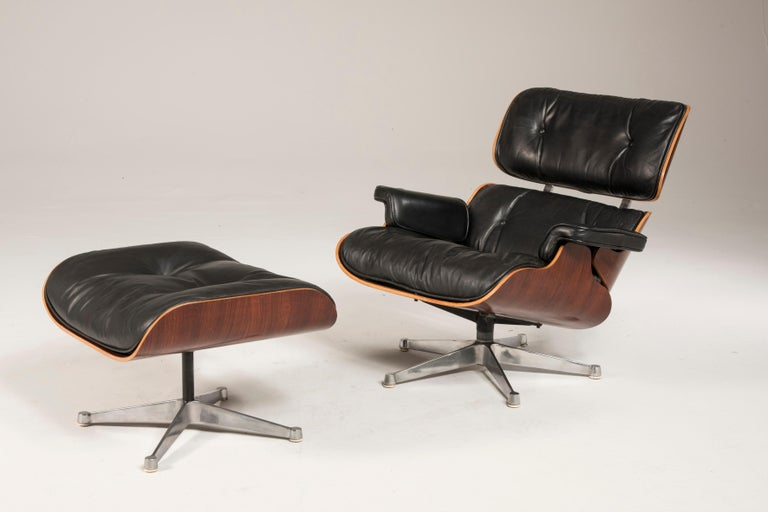 1970s Eames lounge chair and ottoman black leather by ICF 