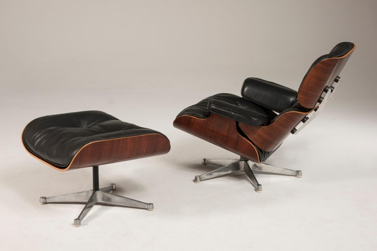 Italian 1970s Eames 670 Lounge Chair and 671 Ottoman Black Leather by ICF For Sale