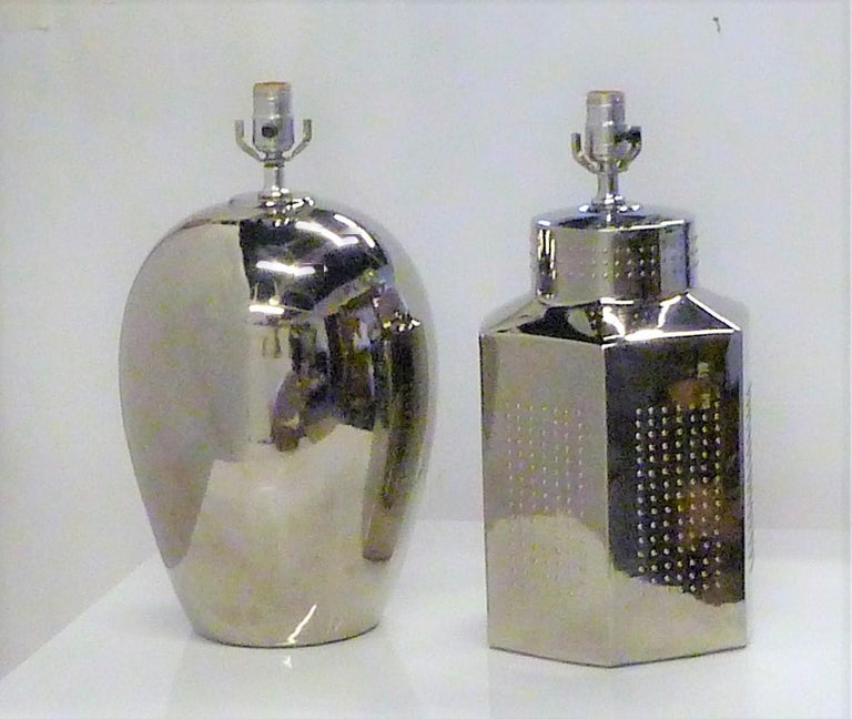 1970s shiny elegance in this pair of complimentary styled mirror glazed pottery lamps from Tyndale. Beautiful original condition, included their harps and finials. One an oval egg shape, the other a tea jar shape with nubs. Two of the pics show