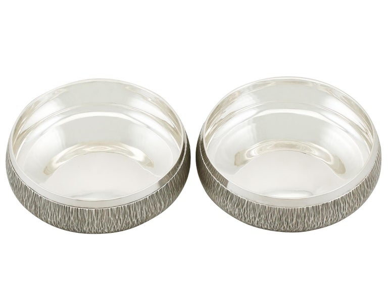 An exceptional, fine and impressive, collectable pair of vintage Elizabeth II English sterling silver coasters made by A G Benney; an addition to our range of collectable wine and drink related silverware.  These exceptional vintage Elizabeth II