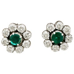 1970s Emerald and 1.45 Carat Diamond White Gold Cluster Earrings