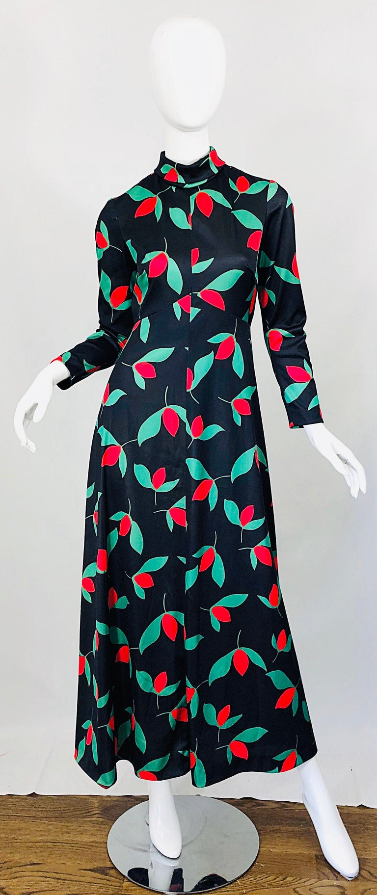 Beautiful and rare vintage 1970s EMILIO BORGHESE black, red and green tulip print long sleeve maxi dress ! Features a sleek tailored bodice with a flattering high neck. Forgiving skirt can fit an array of hip sizes. Hidden zipper up the back with