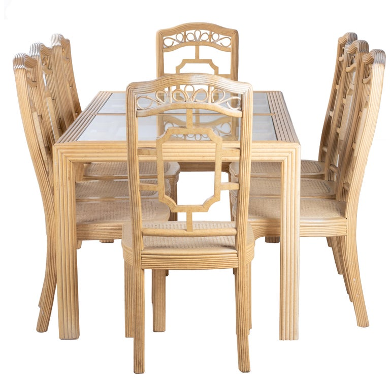 1970s oriental style bamboo dining set composed of eight chairs and table, bought in Harrod's, London.