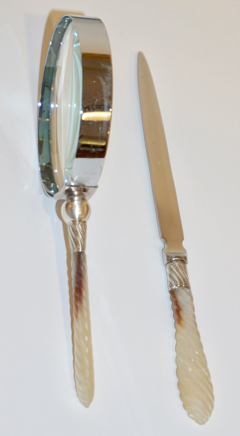 A vintage Mid-Century Modern desk set composed of a magnifying glass and a letter opener with mother of pearl handles in a sophisticated twisted carving, mounted with an engraved sterling silver Art Nouveau style decor supporting the stainless steel