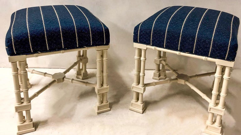 This is a vintage pair of Erwin Lambeth Chinese Chippendale style ottomans that have been newly upholstered in a textured linen. The finish is a satin linen white. They are marked.